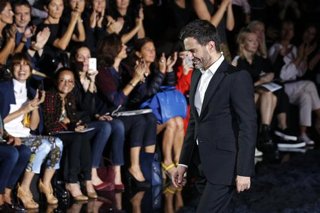 U.S. designer Marc Jacobs appears at the end of his Spring/Summer 2014 women's ready-to-wear fashion show for French fashion house Louis Vui