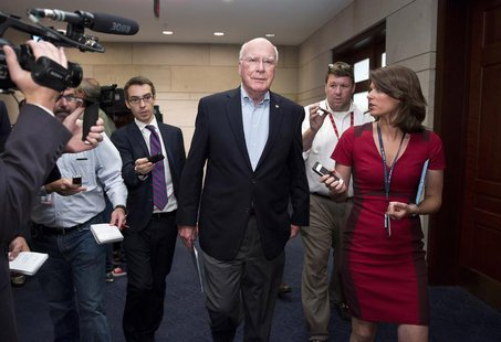 Senator Patrick Leahy (D-VT) (C) speaks to the media after attending a closed meeting for members of Congress on the situation in Syria at t