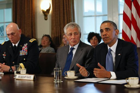 U.S. Army Chief of Staff General Ray Odierno (L) and Secretary of Defense Chuck Hagel listen as President Barack Obama (R) speaks to the med