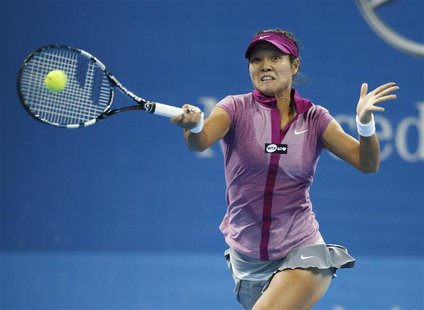 Li Na of China returns a shot against Sabine Lisicki of Germany during their match at the China Open tennis tournament in Beijing October 2,