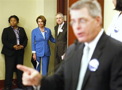 U.S. House Minority Leader Nancy Pelosi (2nd L) and Senate Democratic Majority Leader Harry Reid (3rd L) arrive at a rally to celebrate the