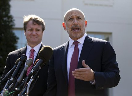 Lloyd Blankfein, Chairman and CEO of The Goldman Sachs Group speaks alongside Brian Moynihan, CEO of Bank of America, after a meeting by the