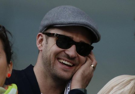 Singer/actor Justin Timberlake watches Rafael Nadal of Spain face Novak Djokovic of Serbia in the men's final match at the U.S. Open tennis