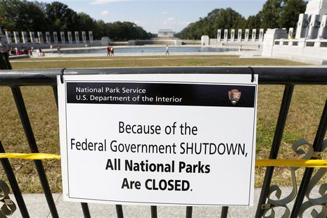 A closure sign is seen on a barricade at the World War Two Memorial in Washington October 1, 2013. REUTERS/Kevin Lamarque
