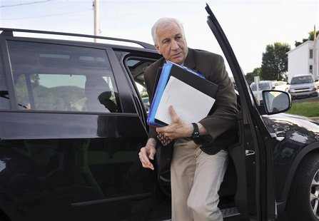 Former Penn State assistant football coach Jerry Sandusky arrives at the Centre County Courthouse for the fourth day of his child sex abuse