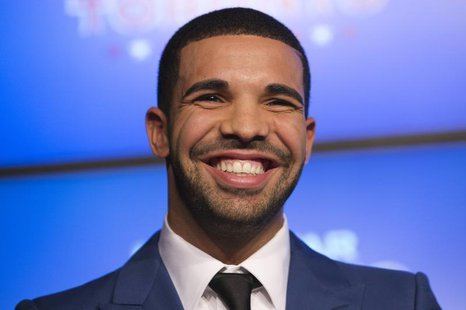 Rapper Drake smiles during an announcement that the Toronto Raptors will host the NBA All-Star game in Toronto, September 30, 2013. REUTERS/