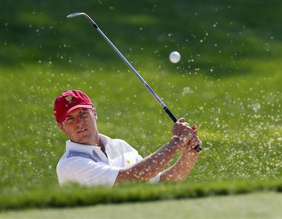U.S. team member Jordan Spieth hits from a sand trap on the 10th hole during the first practice round for the 2013 Presidents Cup golf tourn