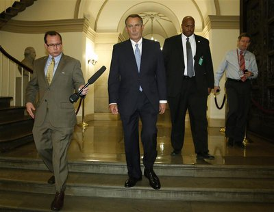 U.S. House Speaker John Boehner (R-OH) (2nd L) departs for a meeting at the White House with President Barack Obama, from the U.S. Capitol i
