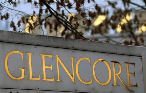 The logo of commodities trader Glencore is pictured in front of the company's headquarters in the Swiss town of Baar November 20, 2012. REUT