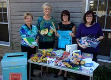 Members of the Harbor Center BID show off the donated school supplies received and given to area students.