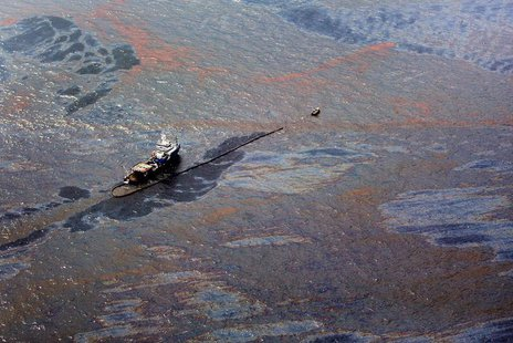 Oil floats on the surface of the Gulf of Mexico around a work boat at the site of the Deepwater Horizon oil spill in the Gulf of Mexico June