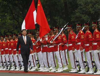 China's President Xi Jinping walks during a welcoming ceremony at the Presidential Palace in Jakarta October 2, 2013. Xi is on a two-day vis