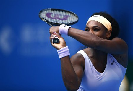 Serena Williams of the U.S. returns the ball during her women's singles match against Maria Kirilenko of Russia at the China Open tennis tou