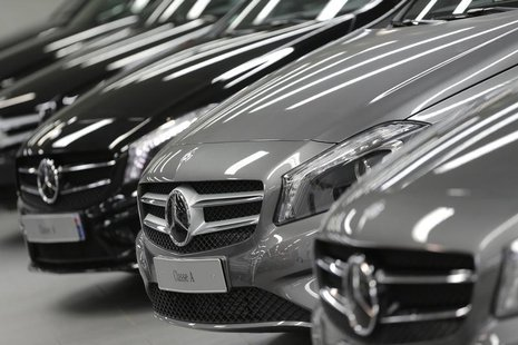 Mercedes-Benz A-class cars are displayed in a dealership of German car manufacturer Daimler in Paris, July 30, 2013. REUTERS/Christian Hartm