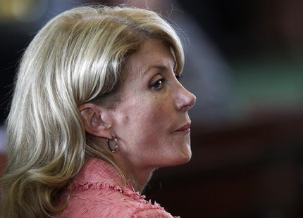 Democratic Senator Wendy Davis listens as the state Senate meets to consider legislation restricting abortion rights in Austin, Texas July 1