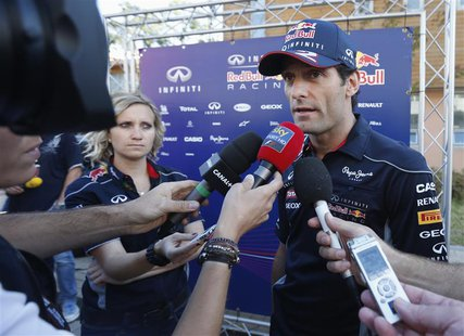 Red Bull Formula One driver Mark Webber of Australia speaks to media at the Korea International Circuit before the Korea F1 Grand Prix in Ye