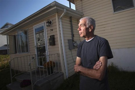 Frank Lettieri, 63, poses outside his home in the Staten Island borough of New York September 20, 2013. REUTERS/Carlo Allegri