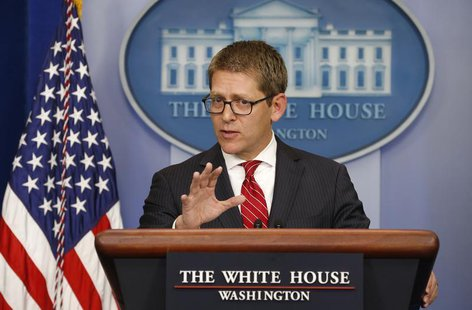 White House Press Secretary Jay Carney speaks to reporters about Obamacare from the briefing room of the White House in Washington September