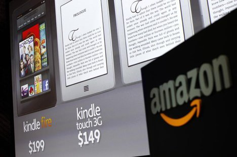 Graphics of the new Amazon Kindle tablets are seen at a news conference during the launch of Amazon's new tablets in New York, September 28,