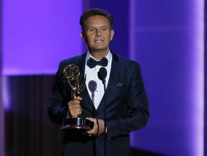"Producer Mark Burnett accepts the award for Outstanding Reality - Competition Program for ""The Voice"" at the 65th Primetime Emmy Awards in L"
