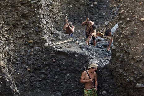 Hand-pickers search for jade through rubble dumped by mining companies at a jade mine in Hpakant township, Kachin State July 7, 2013. REUTER