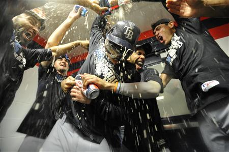 Oct 2, 2013; Cleveland, OH, USA; Tampa Bay Rays starting pitcher Alex Cobb (center) celebrates with pitcher David Price (second right) teammates after defeating the Cleveland Indians in the American League wild card playoff game at Progressive Field. Tampa Bay won 4-0. Mandatory Credit: David Richard-USA TODAY Sports