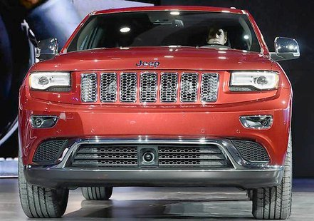 The 2014 Jeep Grand Cherokee is introduced at the North American International Auto Show in Detroit XXSTRINGERXX xxxxx Reuters, / October 2, 2013)