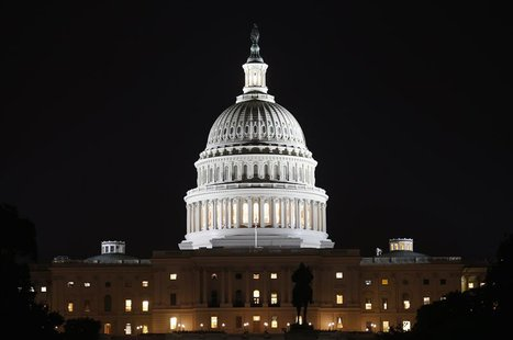 A view of the U.S. Capitol at night, on the eve of a potential federal government shutdown, in Washington September 30, 2013. REUTERS/Kevin