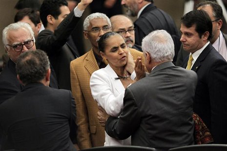 Former Senator Marina Silva is consoled by other lawmakers after the Supreme Electoral Tribunal made the decision not to grant her request t