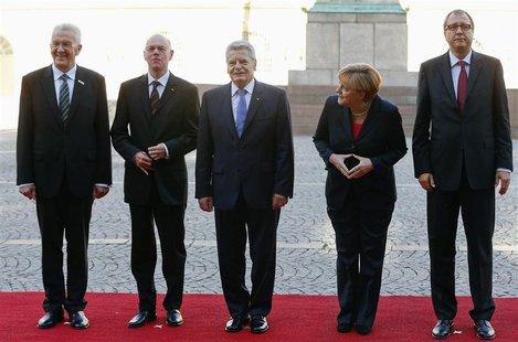 From L-R: Baden-Wuerttemberg's Prime Minister Winfried Kretschmann, Bundestag President Norbert Lammert, German President Joachim Gauck, Ger