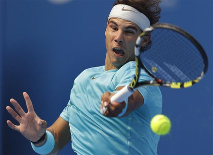 Rafael Nadal of Spain returns a shot during his quarterfinal match against Fabio Fognini of Italy in the China Open tennis tournament at the