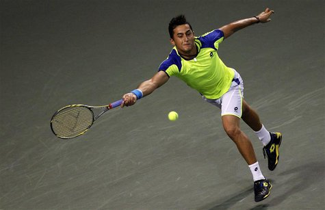 Nicolas Almagro of Spain returns a shot against Kei Nishikori of Japan during their men's singles quarter final match at the Japan Open tenn