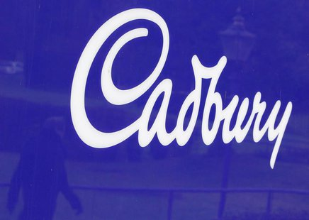 A man is reflected in a sign outside the Cadbury factory in Bournville, central England, in this January 19, 2010 file photo. REUTERS/Darren