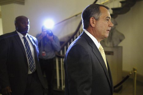 U.S. House Speaker John Boehner (R-OH) (R) arrives at the U.S. Capitol in Washington, October 3, 2013. REUTERS/Jonathan Ernst