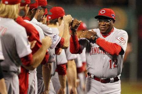 Oct 1, 2013; Pittsburgh, PA, USA; Cincinnati Reds manager Dusty Baker (12) is introduced before National League wild card playoff baseball g