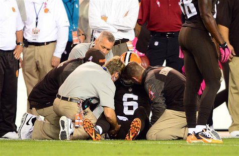 Oct 3, 2013; Cleveland, OH, USA; Cleveland Browns quarterback Brian Hoyer (6) is attended to by medical staff after being injured during the