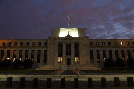 A general view of the U.S. Federal Reserve building as the morning sky breaks over Washington, July 31, 2013. REUTERS/Jonathan Ernst