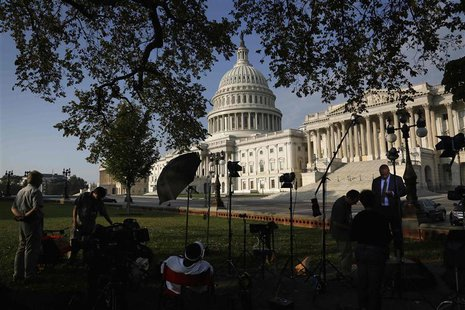 Television news crews set up outside the U.S. Capitol in Washington, October 4, 2013. REUTERS/Jonathan Ernst
