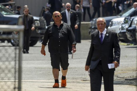 Celebrity chef Mario Batali walks outside the Cathedral Church of Saint John the Divine in New York June 27, 2013, following the funeral ser