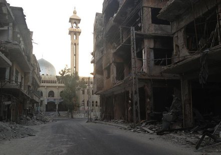 A general view shows damaged buildings along a deserted street in the Damascus suburb of Zamalka September 30, 2013. REUTERS/Stringer