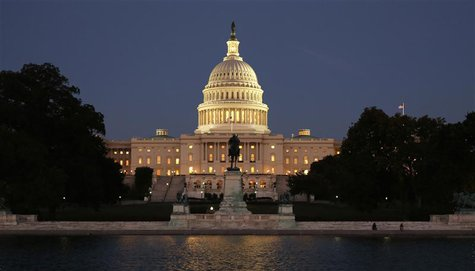 The U.S. Capitol is seen at night on the eve of a potential federal government shutdown, in Washington September 30, 2013. REUTERS/Kevin Lam