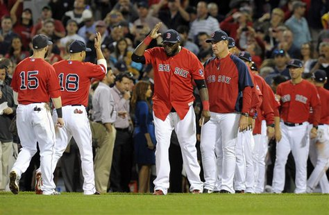 Oct 4, 2013; Boston, MA, USA; Members of the Boston Red Sox including David Ortiz (middle) celebrate after defeating the Tampa Bay Rays in g