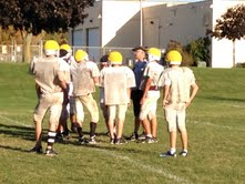 The team huddles around coach Feldmann