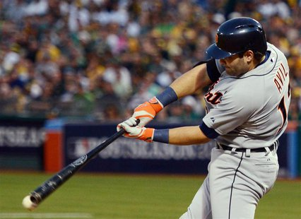 October 4, 2013; Oakland, CA, USA; Detroit Tigers catcher Alex Avila (13) hits a RBI-single to score designated hitter Victor Martinez (41,
