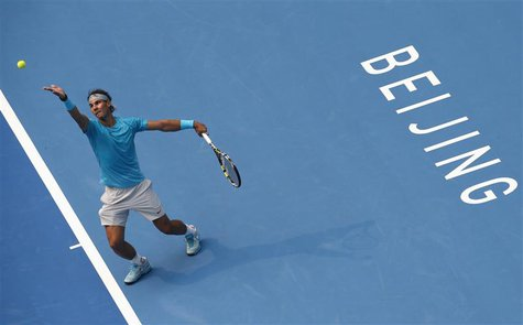 Spain's Rafael Nadal serves during his men's singles semi-final match against Tomas Berdych of the Czech Republic at the China Open tennis t