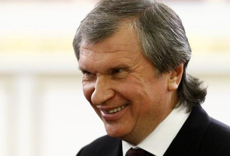 Rosneft President and Chairman of the Management Board Igor Sechin smiles before a signing ceremony after talks with the Chinese delegation