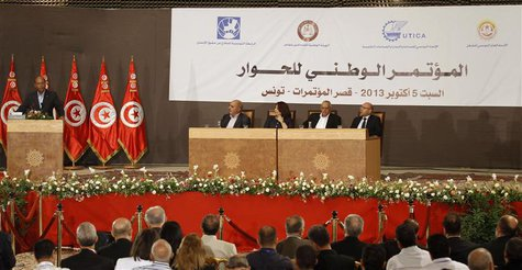 Tunisia's President Moncef Marzouki (L) speaks during the National Conference for Dialogue, which aims to pave the way for the formation of
