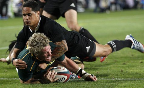 South Africa's captain Jean de Villiers scores a try as he is challenged by New Zealand's All Blacks Aaron Smith (top) during the final roun