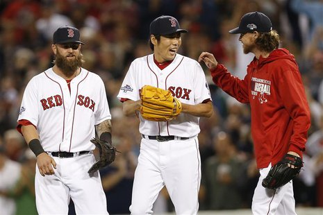Oct 5, 2013; Boston, MA, USA; Boston Red Sox first baseman Mike Napoli (12) celebrates with pitcher Koji Uehara (19) and pitcher Clay Buchho