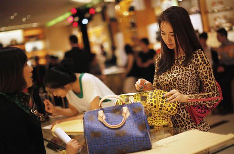 A woman shops in a Louis Vuitton store during Vogue's 4th Fashion's Night Out: Shopping Night with Celebrities in downtown Shanghai Septembe